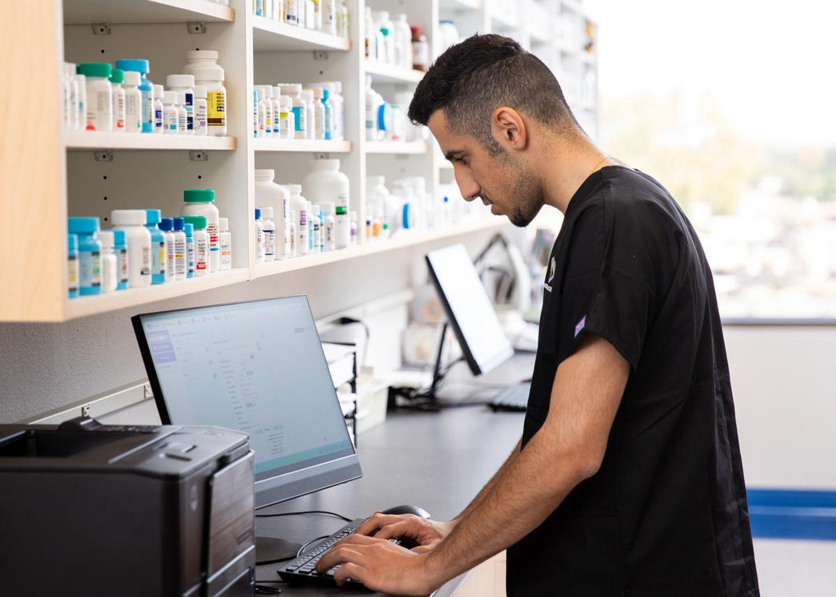Pharmacy student using a computer at Arizona College